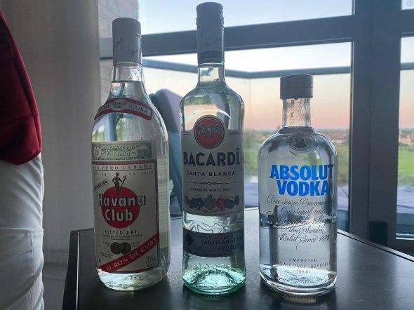 assortment of 5 bottles Rum, Vodka, Ouzo